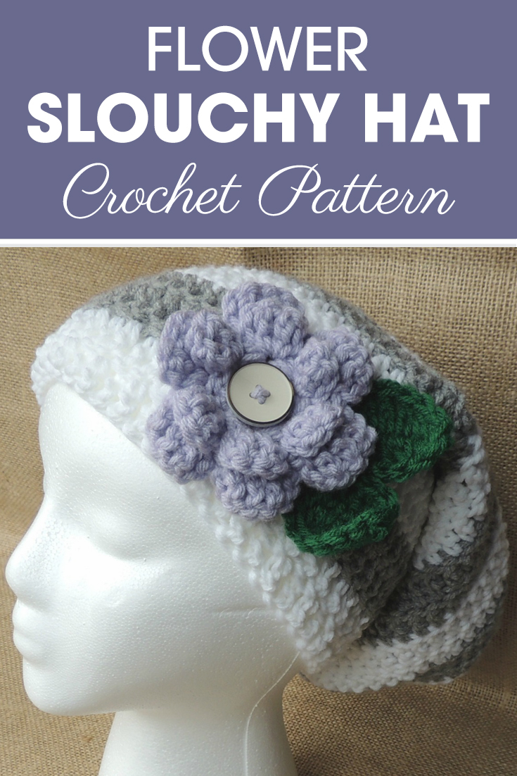 This flower slouchy hat is just too cute! You have to make sure to tell your friends about it. It has stripes all the way down, ribbed edging, and the cutest flower with 2 leaves! #crochet #crochetlove #crochetaddict #crochetpattern #crochetinspiration #ilovecrochet #crochetgifts #crochet365 #addictedtocrochet #yarnaddict #yarnlove #crochethat