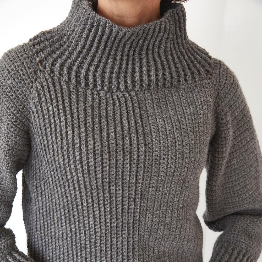 The Roll Neck Sweater is the perfect elegant piece to wear to a family Christmas party, or for a walk in the autumnal breeze. #crochetsweater #crochetpullover #crochetlove #crochetaddict
