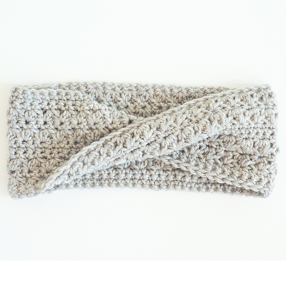 This free crochet pattern will keep your ears warm and your hair looking good. This crochet headband is such a fun and beautiful project to make. #CrochetHeadband #CrochetPattern #CrochetAddict
