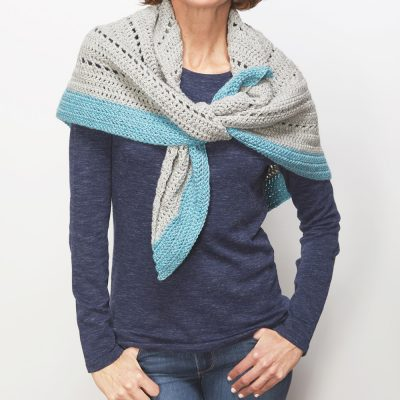 This crochet shawl wrap is the perfect way to keep warm this winter. The free crochet pattern is so easy to construct and fun too. #CrochetShawl #ShawlCrochetPattern #CrochetPattern #CrochetAddict