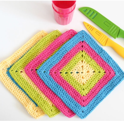 Colorful Solid Granny Square Dishcloth - Crochet dishcloth patterns are fun to work up and faster than any others. #EasyCrochetDishclothPatterns #crochetpatterns #dishclothpatterns #crochetaddict