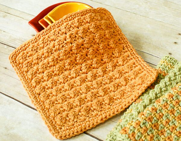 Textured Crochet Dishcloth - Crochet dishcloth patterns are fun to work up and faster than any others. #EasyCrochetDishclothPatterns #crochetpatterns #dishclothpatterns #crochetaddict