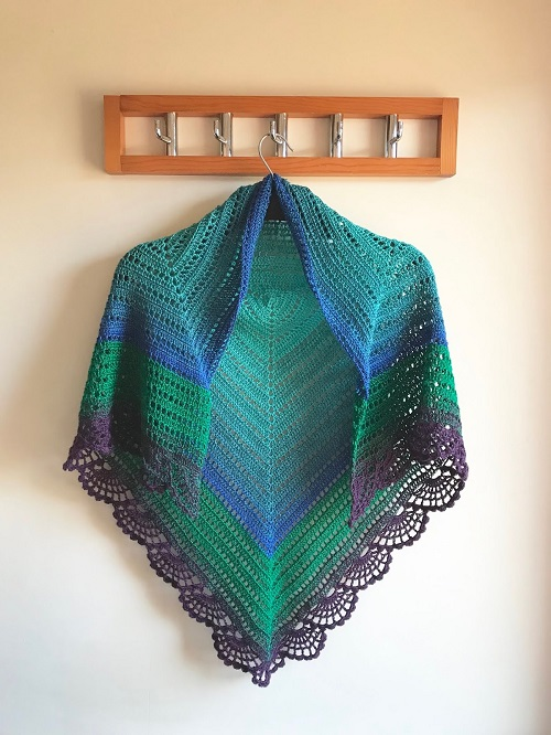 The Peafowl Feathers Shawl - This list has 20 free crochet shawl patterns, each unique and suitable for any occasion. These are the best shawl patterns out there. #CrochetShawlPatterns #CrochetShawl #FreeCrochetPatterns