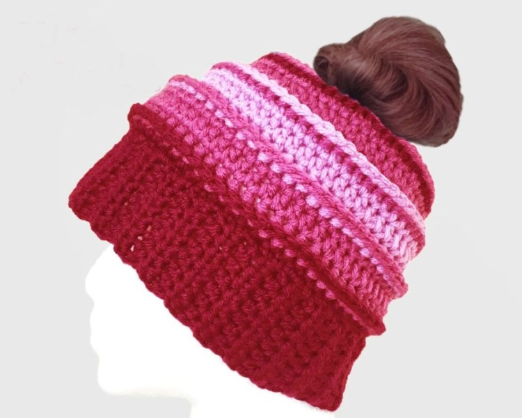 Be Mine Messy Bun Hat - These crochet hat patterns are so stylish and fun to make. Each one uses different crochet stitches to create one of a kind designs. #MessyBunHatCrochetPatterns #HatCrochetPatterns #CrochetPatterns
