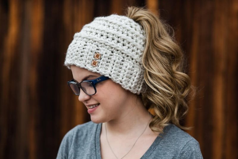 Beehive Messy Bun Hat - These crochet hat patterns are so stylish and fun to make. Each one uses different crochet stitches to create one of a kind designs. #MessyBunHatCrochetPatterns #HatCrochetPatterns #CrochetPatterns