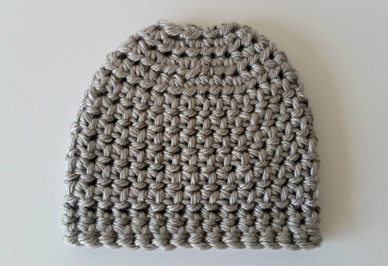 Breezy & Easy Messy Bun Beanie - These crochet hat patterns are so stylish and fun to make. Each one uses different crochet stitches to create one of a kind designs. #MessyBunHatCrochetPatterns #HatCrochetPatterns #CrochetPatterns