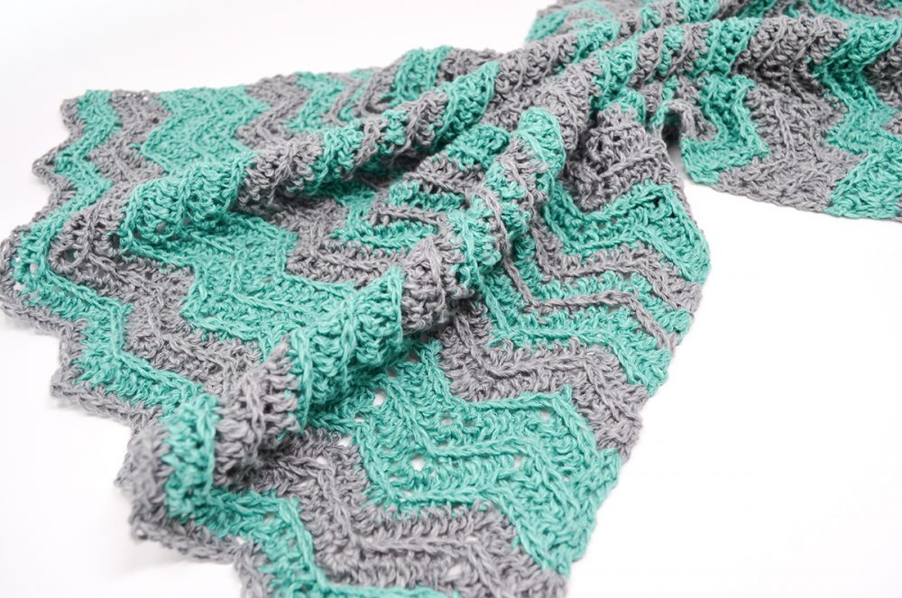 Chevron Flare Blanket - These crochet blankets are so pretty and an adventure to make. Test out your stitch knowledge with these exciting afghan patterns. #ChevronCrochetBlanket #CrochetBlanket #CrochetPatterns