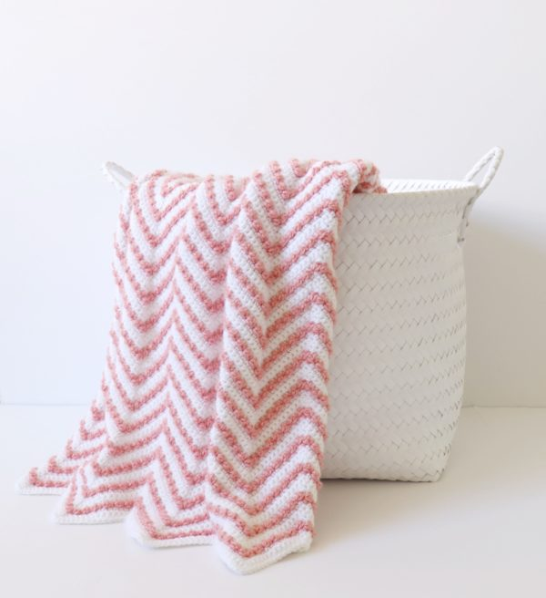 Berry Chevron Baby Blanket - These crochet blankets are so pretty and an adventure to make. Test out your stitch knowledge with these exciting afghan patterns. #ChevronCrochetBlanket #CrochetBlanket #CrochetPatterns