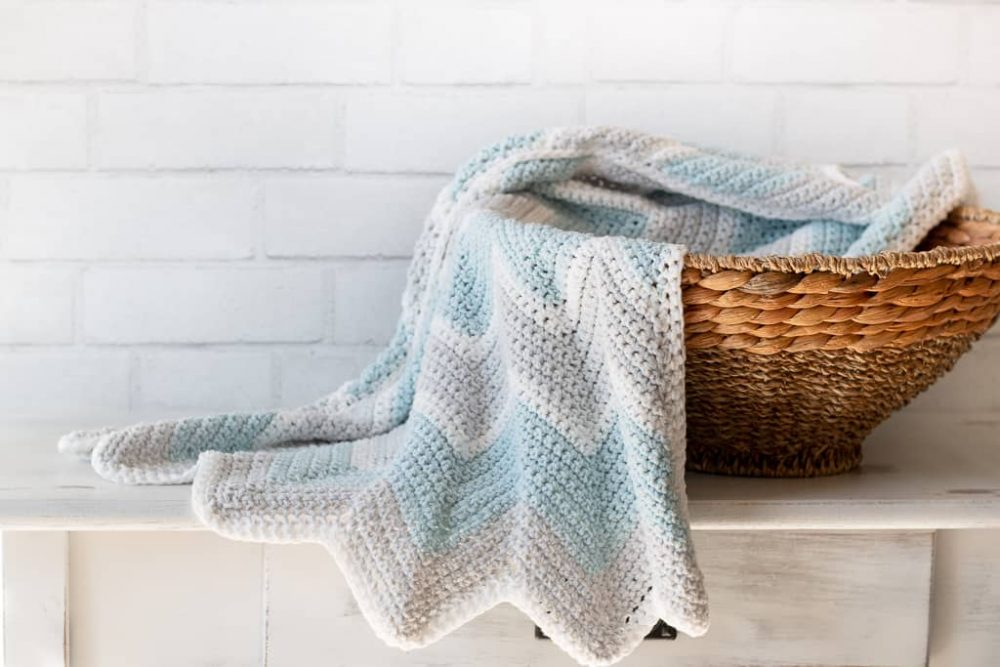 Chevron Baby Blanket - These crochet blankets are so pretty and an adventure to make. Test out your stitch knowledge with these exciting afghan patterns. #ChevronCrochetBlanket #CrochetBlanket #CrochetPatterns