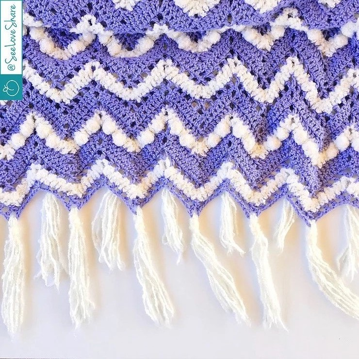 Purple & Puff Chevron Blanket - These crochet blankets are so pretty and an adventure to make. Test out your stitch knowledge with these exciting afghan patterns. #ChevronCrochetBlanket #CrochetBlanket #CrochetPatterns