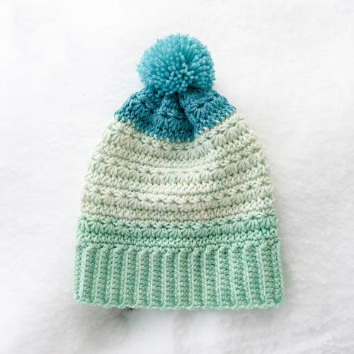 Snow Drops Messy Bun Hat - These crochet hat patterns are so stylish and fun to make. Each one uses different crochet stitches to create one of a kind designs. #MessyBunHatCrochetPatterns #HatCrochetPatterns #CrochetPatterns