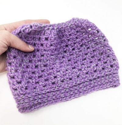 Easy Peasy Messy Bun Hat - These crochet hat patterns are so stylish and fun to make. Each one uses different crochet stitches to create one of a kind designs. #MessyBunHatCrochetPatterns #HatCrochetPatterns #CrochetPatterns