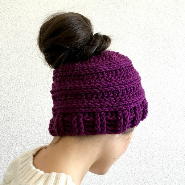 Messy Bun Hat - These crochet hat patterns are so stylish and fun to make. Each one uses different crochet stitches to create one of a kind designs. #MessyBunHatCrochetPatterns #HatCrochetPatterns #CrochetPatterns