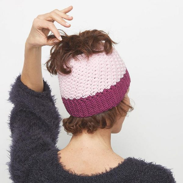 Pretty Pink Messy Bun Hat - These crochet hat patterns are so stylish and fun to make. Each one uses different crochet stitches to create one of a kind designs. #MessyBunHatCrochetPatterns #HatCrochetPatterns #CrochetPatterns