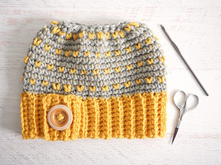 Retro Messy Bun Hat - These crochet hat patterns are so stylish and fun to make. Each one uses different crochet stitches to create one of a kind designs. #MessyBunHatCrochetPatterns #HatCrochetPatterns #CrochetPatterns