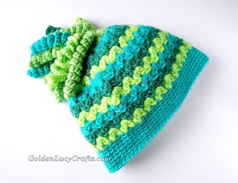 Spiral Top Messy Bun Hat - These crochet hat patterns are so stylish and fun to make. Each one uses different crochet stitches to create one of a kind designs. #MessyBunHatCrochetPatterns #HatCrochetPatterns #CrochetPatterns