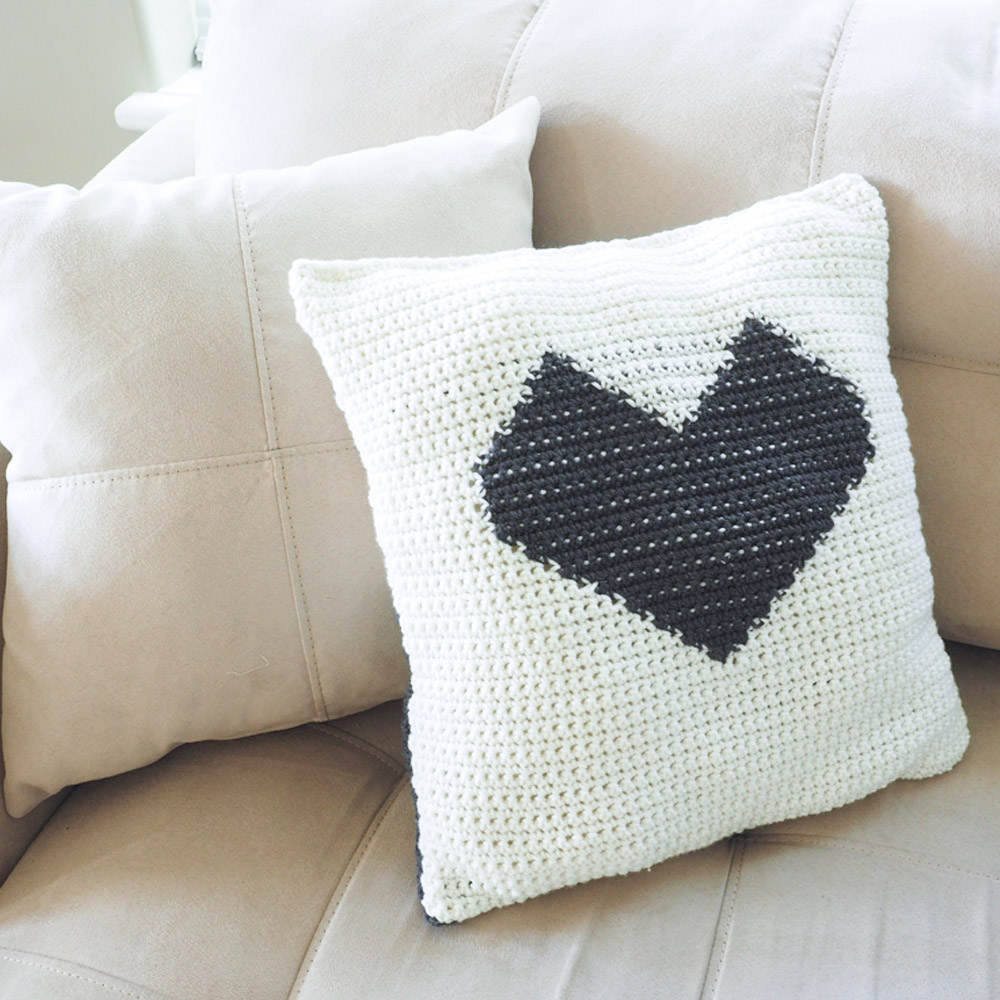 This crochet throw pillow is perfect for brightening up a space in a subtle way. You'll get to learn the crochet graphgan technique on a smaller scale. #CrochetPillow #CrochetPillowPatterns #CrochetPatterns