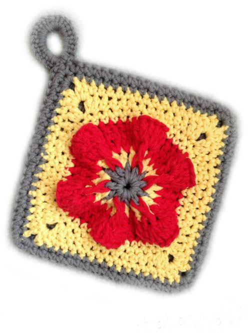 Penelope's Pretty Petunia Potholder - These crochet pot holders aren't challenging to work up and provide a nice lazy day project. Pick out a pot holder pattern and get to work. #CrochetPotHolders #CrochetPatterns #EasyCrochetPatterns