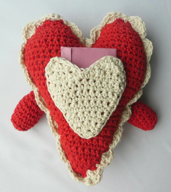 Crochet Heart Pillow Buddy - These are the best pillows and they're all so beautiful. There are more fun, vibrant designs and more modern crochet pillows on this list. #EasyCrochetPillows #CrochetPillows #CrochetPatterns