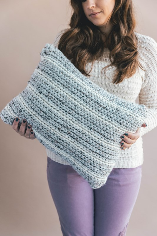 Crochet Knit-Look Pillow - These are the best pillows and they're all so beautiful. There are more fun, vibrant designs and more modern crochet pillows on this list. #EasyCrochetPillows #CrochetPillows #CrochetPatterns