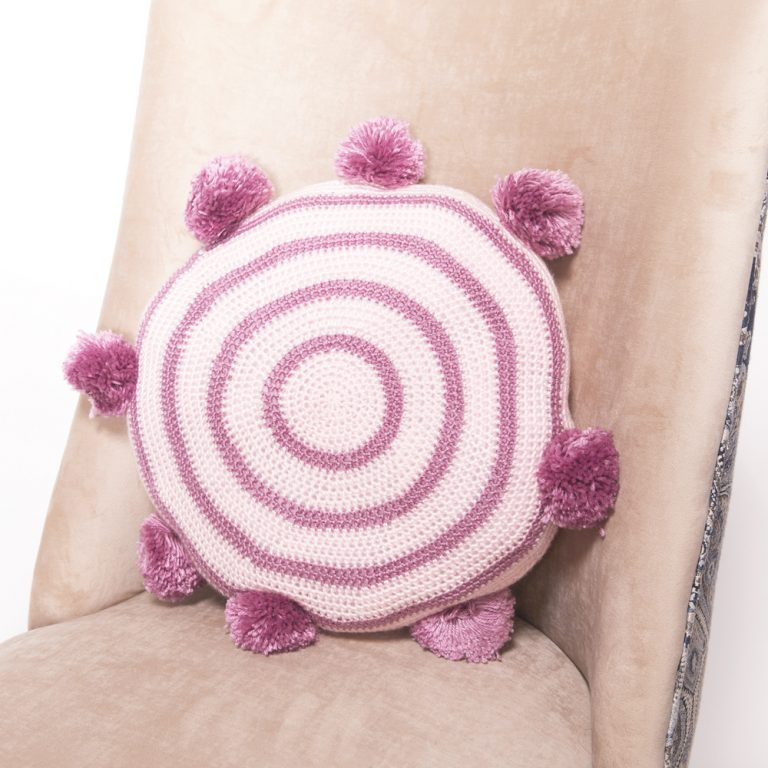 Crochet Pom Pom Cushion - These are the best pillows and they're all so beautiful. There are more fun, vibrant designs and more modern crochet pillows on this list. #EasyCrochetPillows #CrochetPillows #CrochetPatterns