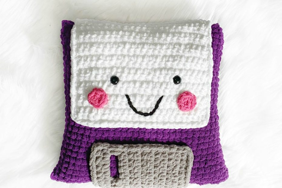 Floppy Disk Cuddle Buddy - These are the best pillows and they're all so beautiful. There are more fun, vibrant designs and more modern crochet pillows on this list. #EasyCrochetPillows #CrochetPillows #CrochetPatterns