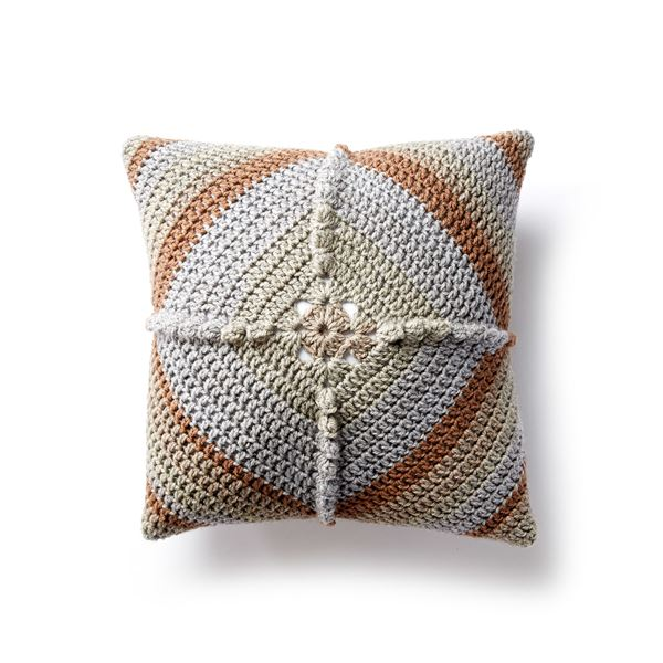 Granny Square Crochet Pillow - These are the best pillows and they're all so beautiful. There are more fun, vibrant designs and more modern crochet pillows on this list. #EasyCrochetPillows #CrochetPillows #CrochetPatterns