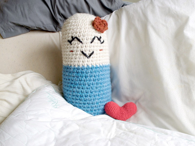 Happy Pill-O - These are the best pillows and they're all so beautiful. There are more fun, vibrant designs and more modern crochet pillows on this list. #EasyCrochetPillows #CrochetPillows #CrochetPatterns