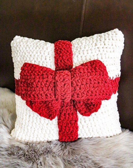 Present Pillow - These are the best pillows and they're all so beautiful. There are more fun, vibrant designs and more modern crochet pillows on this list. #EasyCrochetPillows #CrochetPillows #CrochetPatterns