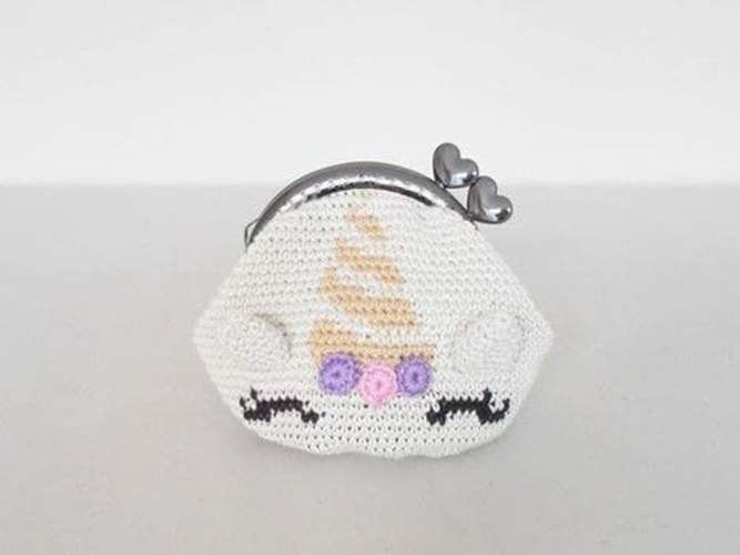 Unicorn Coin Purse - These free crochet purse patterns are full of creative, adventurous ideas. Switch up your look or gift a friend one of these new crochet bags. #CrochetPursePatterns #CrochetPatterns #FreeCrochetPatterns