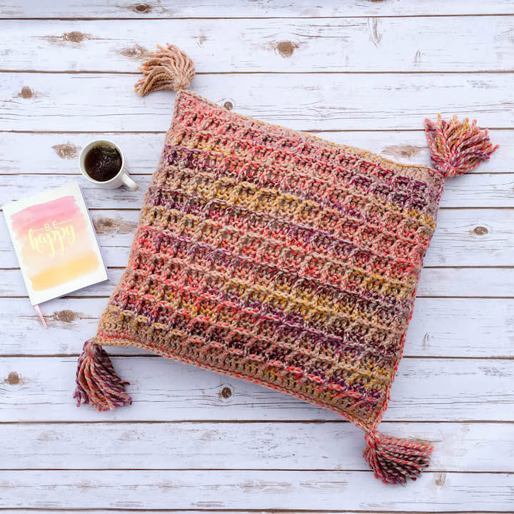 Waffle Stitch Throw Pillow - These are the best pillows and they're all so beautiful. There are more fun, vibrant designs and more modern crochet pillows on this list. #EasyCrochetPillows #CrochetPillows #CrochetPatterns