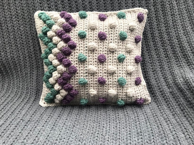 Zigzag Bobble Pillow - These are the best pillows and they're all so beautiful. There are more fun, vibrant designs and more modern crochet pillows on this list. #EasyCrochetPillows #CrochetPillows #CrochetPatterns
