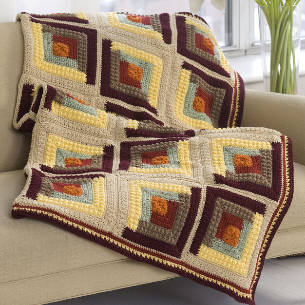 Autumn Log Cabin Throw - We're celebrating the arrival of Fall by putting together these Fall-inspired free crochet blanket patterns. #freecrochetblanketpatterns #crochetpatterns #fallcrochetblankets