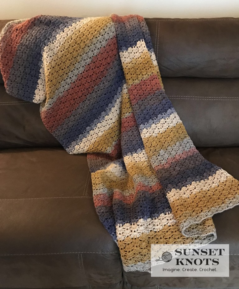 Autumn Shell Blanket - We're celebrating the arrival of Fall by putting together these Fall-inspired free crochet blanket patterns. #freecrochetblanketpatterns #crochetpatterns #fallcrochetblankets