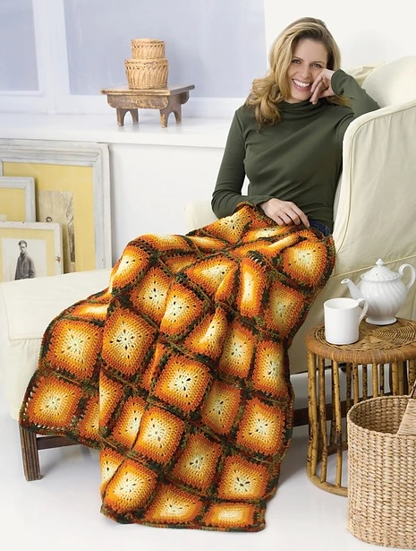 Autumn Squares Blanket - We're celebrating the arrival of Fall by putting together these Fall-inspired free crochet blanket patterns. #freecrochetblanketpatterns #crochetpatterns #fallcrochetblankets