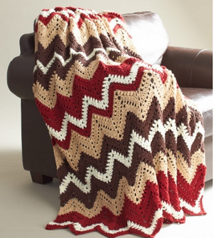 Cozy Cabin Afghan - We're celebrating the arrival of Fall by putting together these Fall-inspired free crochet blanket patterns. #freecrochetblanketpatterns #crochetpatterns #fallcrochetblankets