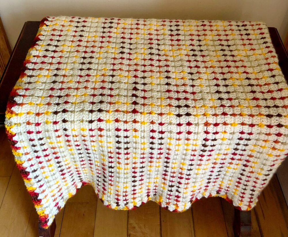 Crochet Fireside Throw Blanket - We're celebrating the arrival of Fall by putting together these Fall-inspired free crochet blanket patterns. #freecrochetblanketpatterns #crochetpatterns #fallcrochetblankets