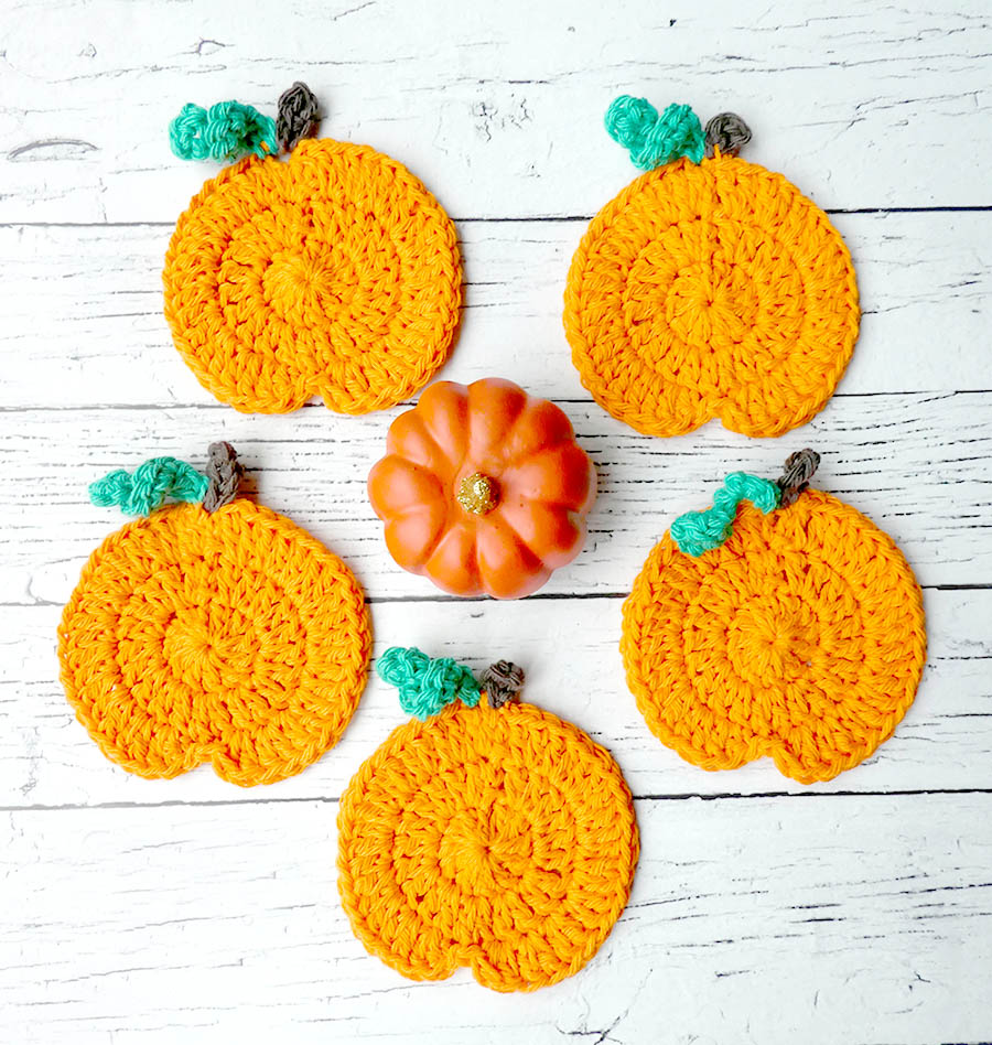 Crochet Pumpkin Coasters - These 13 crochet Halloween pumpkin patterns should be enough to create all the pumpkins you want. #crochethalloweenpumpkins #crochetpatterns #halloweencrochetpatterns
