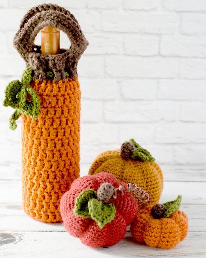 Crochet Pumpkin Wine Cozy - These 13 crochet Halloween pumpkin patterns should be enough to create all the pumpkins you want. #crochethalloweenpumpkins #crochetpatterns #halloweencrochetpatterns