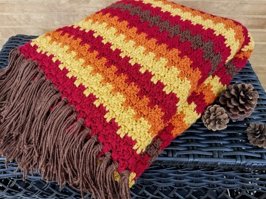 Fall Foliage Afghan - We're celebrating the arrival of Fall by putting together these Fall-inspired free crochet blanket patterns. #freecrochetblanketpatterns #crochetpatterns #fallcrochetblankets