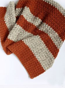 Fall Pumpkin Blanket - We're celebrating the arrival of Fall by putting together these Fall-inspired free crochet blanket patterns. #freecrochetblanketpatterns #crochetpatterns #fallcrochetblankets