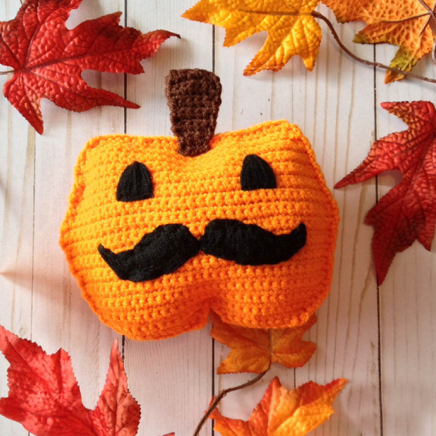 Jacques-o-Lantern Rag Doll - These 13 crochet Halloween pumpkin patterns should be enough to create all the pumpkins you want. #crochethalloweenpumpkins #crochetpatterns #halloweencrochetpatterns