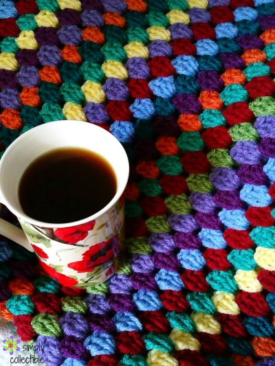 Lily's Garden Striped Granny Afghan - We're celebrating the arrival of Fall by putting together these Fall-inspired free crochet blanket patterns. #freecrochetblanketpatterns #crochetpatterns #fallcrochetblankets