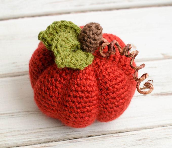 Medium Crochet Pumpkin - These 13 crochet Halloween pumpkin patterns should be enough to create all the pumpkins you want. #crochethalloweenpumpkins #crochetpatterns #halloweencrochetpatterns