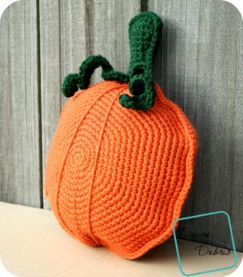 Pauline Pumpkin Pillow - These 13 crochet Halloween pumpkin patterns should be enough to create all the pumpkins you want. #crochethalloweenpumpkins #crochetpatterns #halloweencrochetpatterns