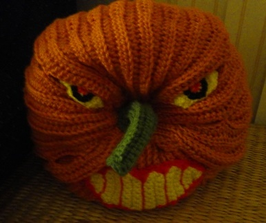 Scary Halloween Pumpkin - These 13 crochet Halloween pumpkin patterns should be enough to create all the pumpkins you want. #crochethalloweenpumpkins #crochetpatterns #halloweencrochetpatterns