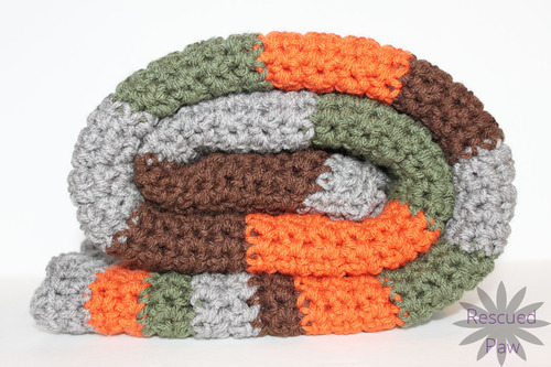 Woodland Stripes Crochet Blanket - We're celebrating the arrival of Fall by putting together these Fall-inspired free crochet blanket patterns. #freecrochetblanketpatterns #crochetpatterns #fallcrochetblankets