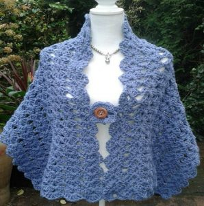 Lace Shell Stitch Shawl - No matter what you're looking for these crochet shawl patterns will allow you to learn, grow and express yourself! #crochetshawlpatterns #crochetpatterns #freecrochetpatterns