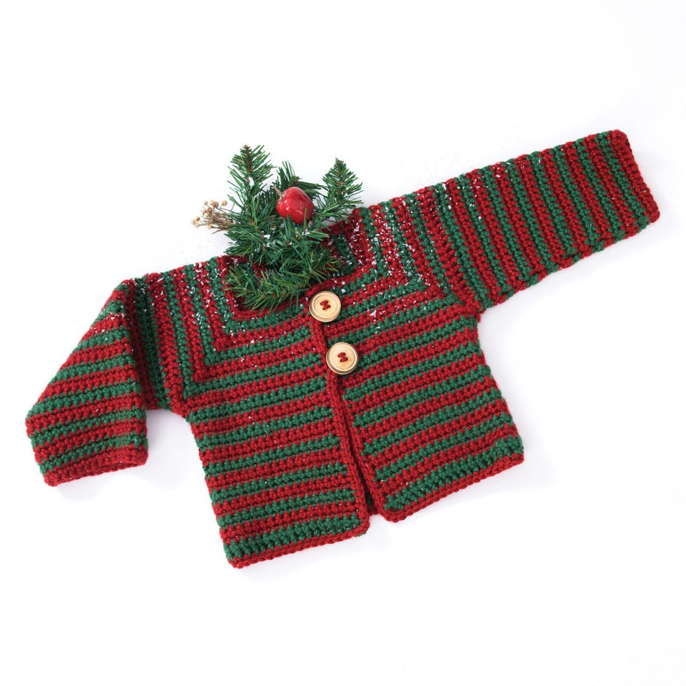 Caron Mitered Striped Baby Sweater - Here are 13 free crochet sweater patterns for the holiday season, including adorable outfits for baby, and out-of-this-world ugly Christmas sweaters! #freecrochetsweaterpatterns #crochetpatterns #crochetsweaters