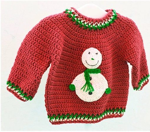 Christmas Sweater - Here are 13 free crochet sweater patterns for the holiday season, including adorable outfits for baby, and out-of-this-world ugly Christmas sweaters! #freecrochetsweaterpatterns #crochetpatterns #crochetsweaters